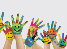 children's hands painted with bright vibrant colors and smiley face drawings